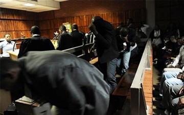 South African Police Denied Bail in Dragging Case