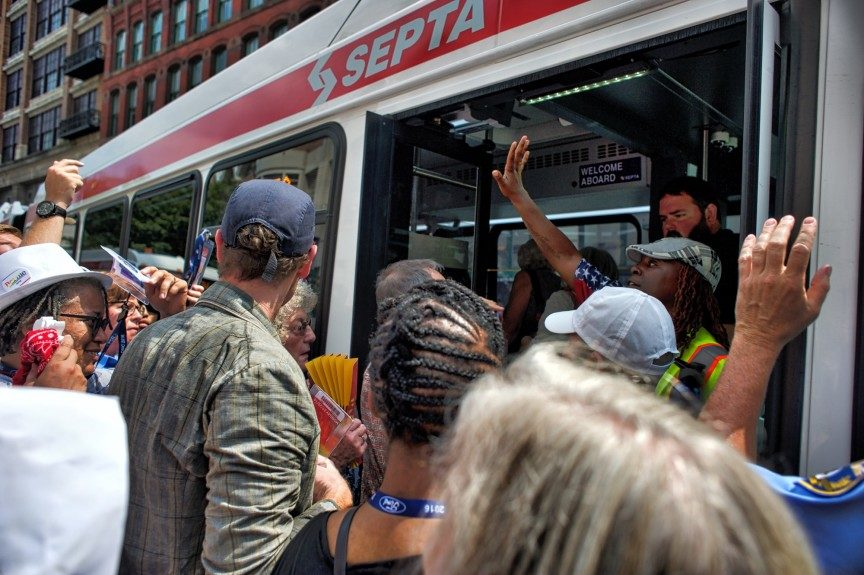 Passengers board shuttle bus to Wells Fargo Center from Philadelphia Convention Center Photo: Geoff Black/EBONY