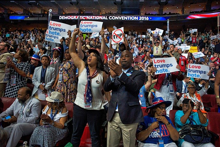 Delegates cheer on the convention floor at the Wells Fargo Center. Photo: Geoff Black/EBONY