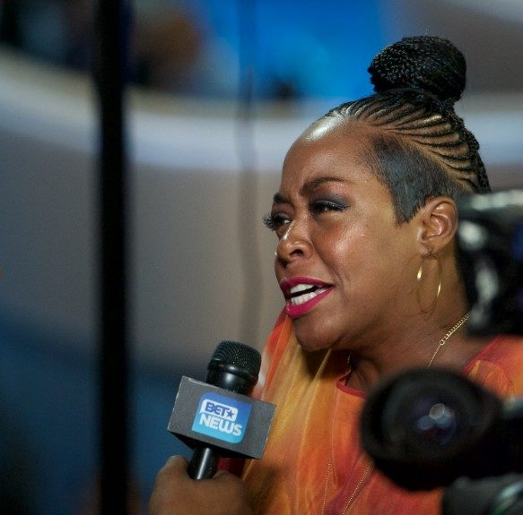 Actress Tichina Arnold speaks to reporters at the convention. (Photo: Geoffrey Black/EBONY)