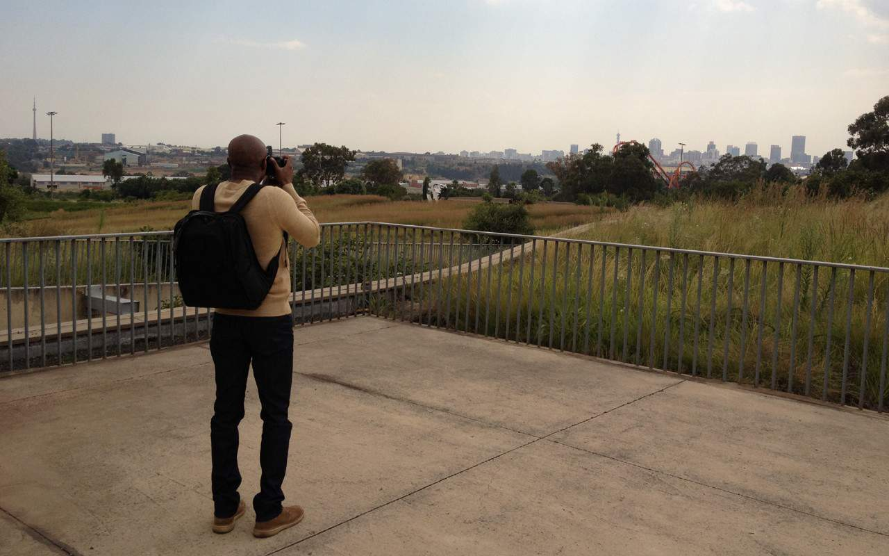 KEM photographing Johannesburg in the distance