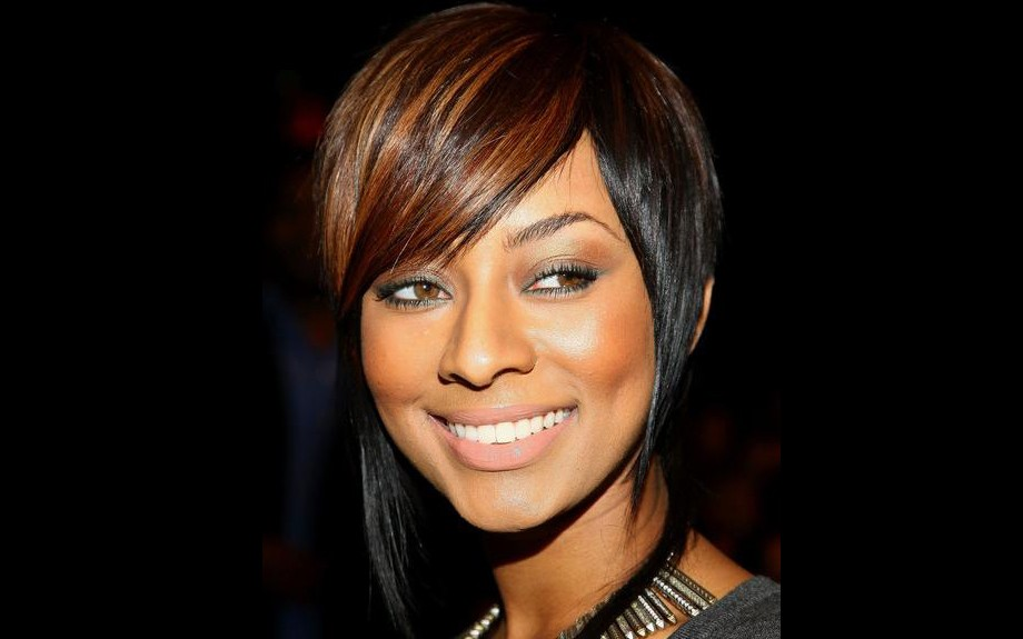 Keri Hilson owns hair color. In this look, she's streaked in auburn goodness!