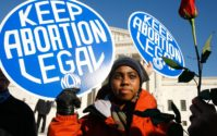 Roe v Wade abortion march protest african american woman
