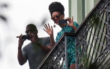 Beyoncé and Jay-Z, are seen on a balcony of a hotel in Havana, Cuba on April 5, 2013.
