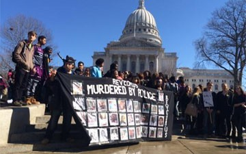 Madison students march in protest of Robinson shooting