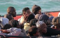 Libya migrants: Sight of rescuers 'led to capsize'