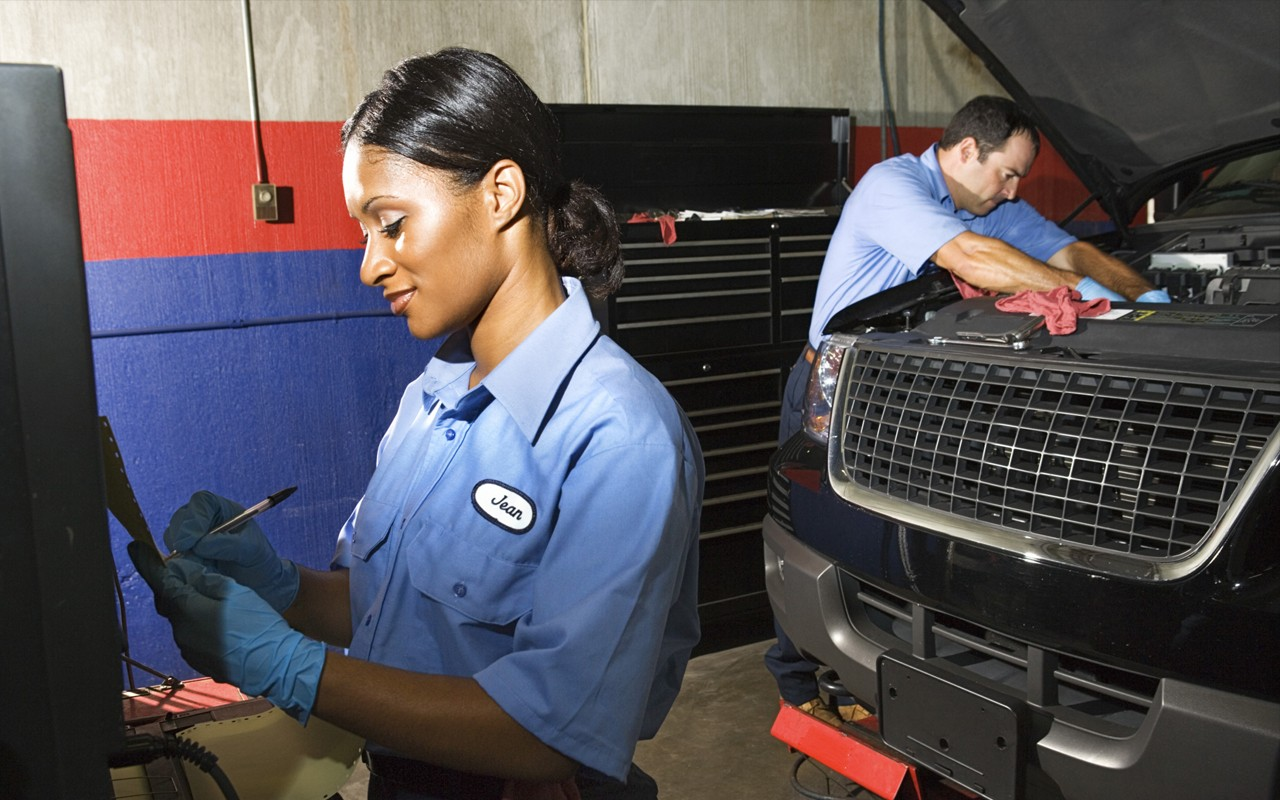 black african american woman auto mechanic working