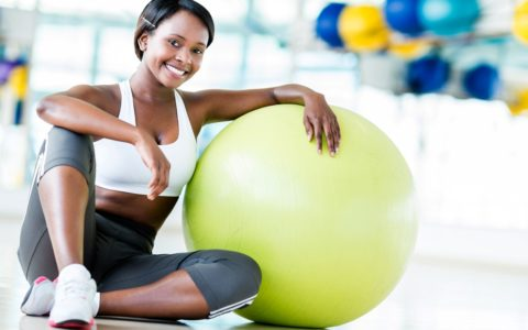 african american woman exercise ball