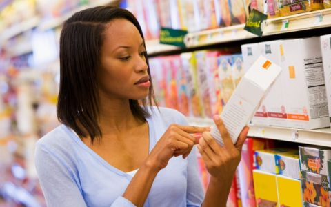 african american woman nutrition label box shopping