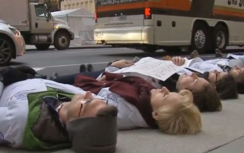 Chicago Protesters Stage Die-In at City Hall