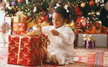 Child opening presents on Christmas