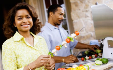 african american couple cooking