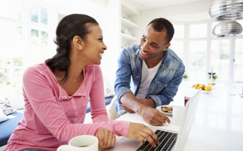 african american couple with laptop