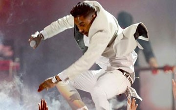 Miguel Jumps on Fans' Heads in Freak Accident
