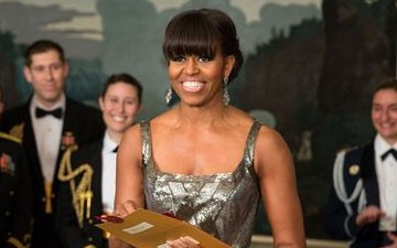 First Lady Michelle Obama presents the Oscar