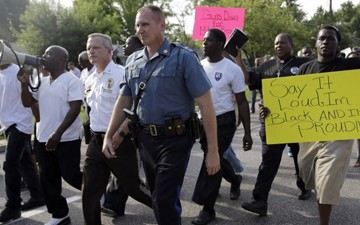 With Highway Patrol, hugs and kisses replace tear gas in Ferguson