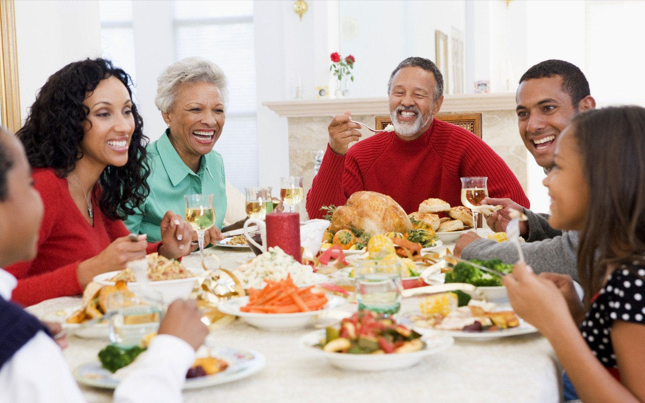african american family eating holidays`