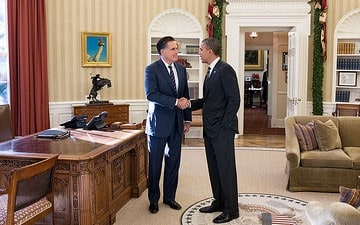 President Obama and former Massachusetts governor Mitt Romney talk in the Oval Office after their lunch.