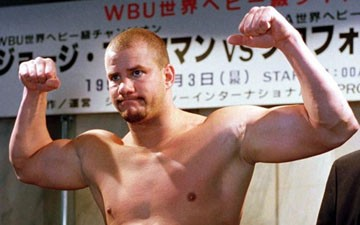 Tommy Morrison poses during a weigh-in in Tokyo on Nov. 2, 1996.