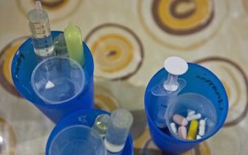 Daily medications for young children with HIV include both tablets and liquid drugs in syringes.