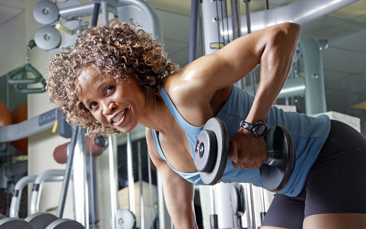 african american woman muscle weight lifting