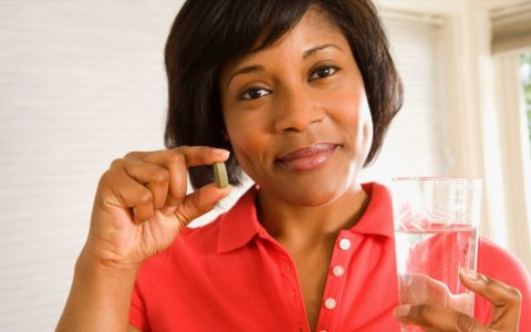 african american woman taking pill