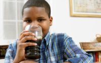 african american child drinking soda