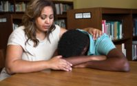 african american teen depression consoled