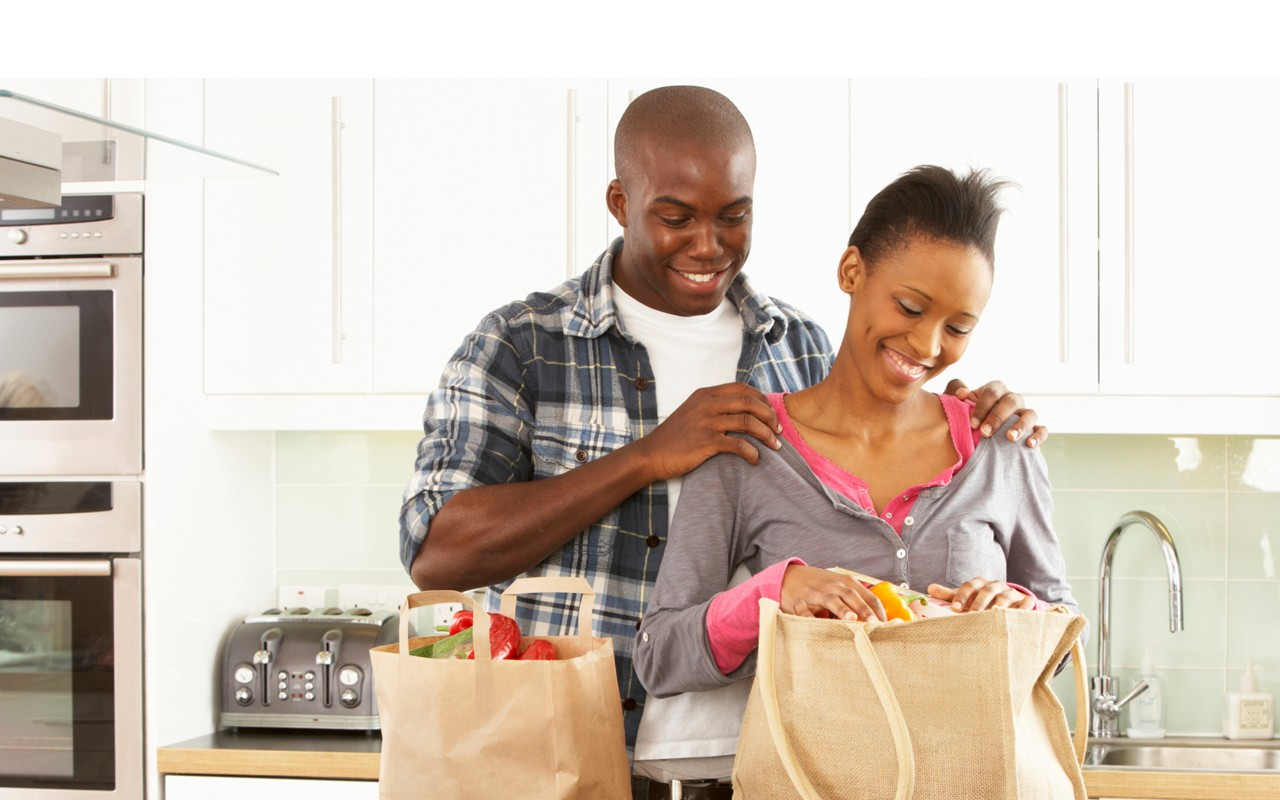 african american couple home groceries