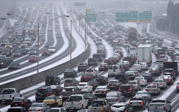 A commute turns into a nightmare -- and boredom -- as storm paralyzes Atlanta