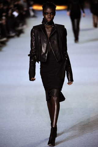 Jeniel Williams' signature edgy coils compliments this super sleek leather look