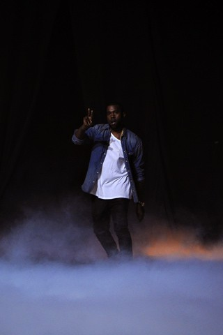 Kanye West greets audience after the show. What do you think fashion heads?