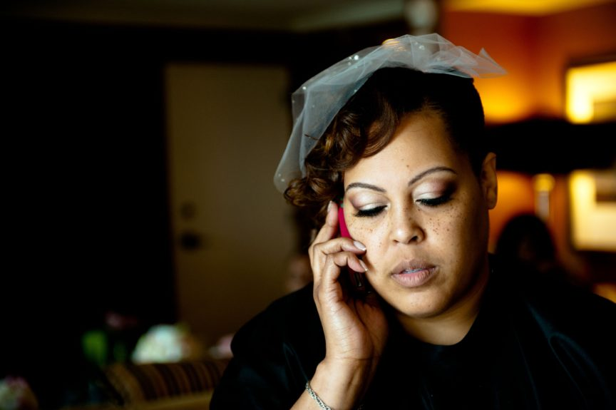 It's all about vintage style, and bride Ivori Lipscomb-Warren channel this look in a white fascinator against retro backdrop