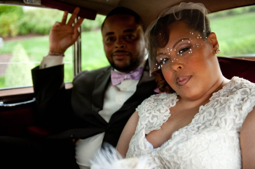 Old school all the way! The bride Ivori Lipscomb-Warren joins her groom Kevin Warren in the obligatory wedding backseat shot! Kevin wears a lavender bow tie for a pop of color