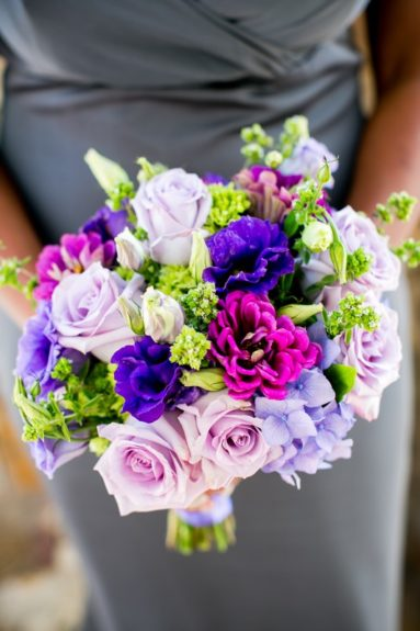 Beautiful shades of purple flowers accented the wedding party's looks.