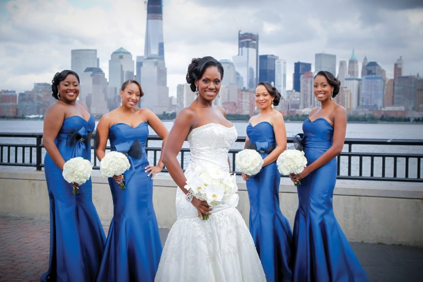 The bridesmaids wore rich deep sea blue, strapless gowns, which looked great against the city skyline
