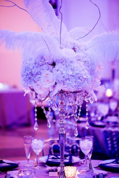 The centerpieces were composed of antique jewels and gorgeous feathers
