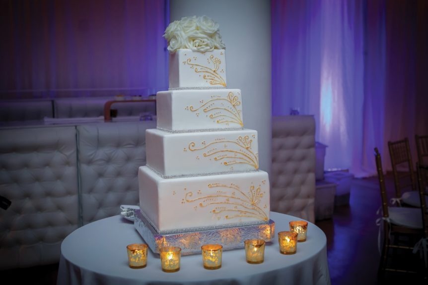 The wedding cake matched their reception design: classic, elegant and timeless