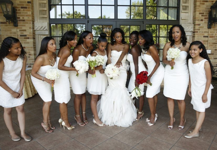 This bride wasn't afraid to be outdone; her bridal party rocked white strapless knee length dresses.