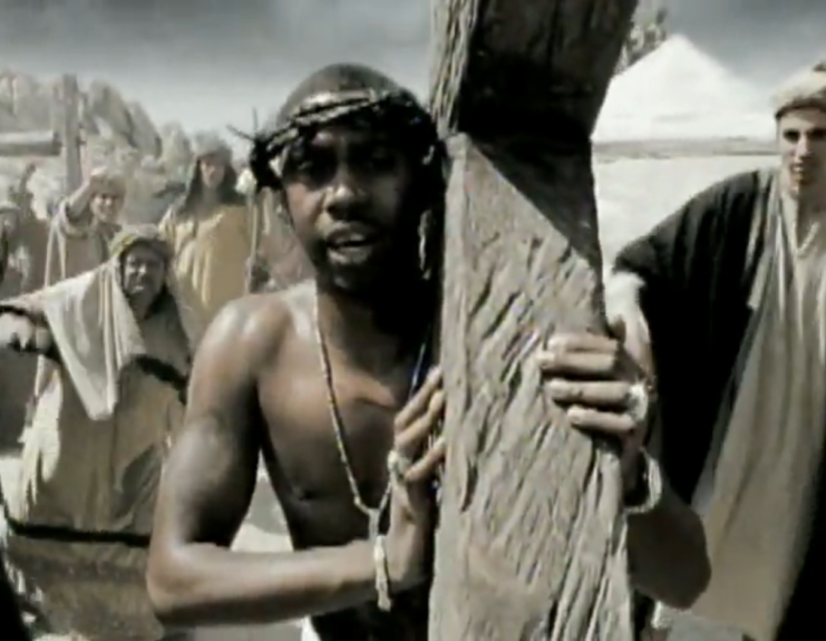 """Hip-hop blasphemy? Nas carries the cross on Diddy's (almost immediately never seen again) 1999 """"Hate Me Now."""""""