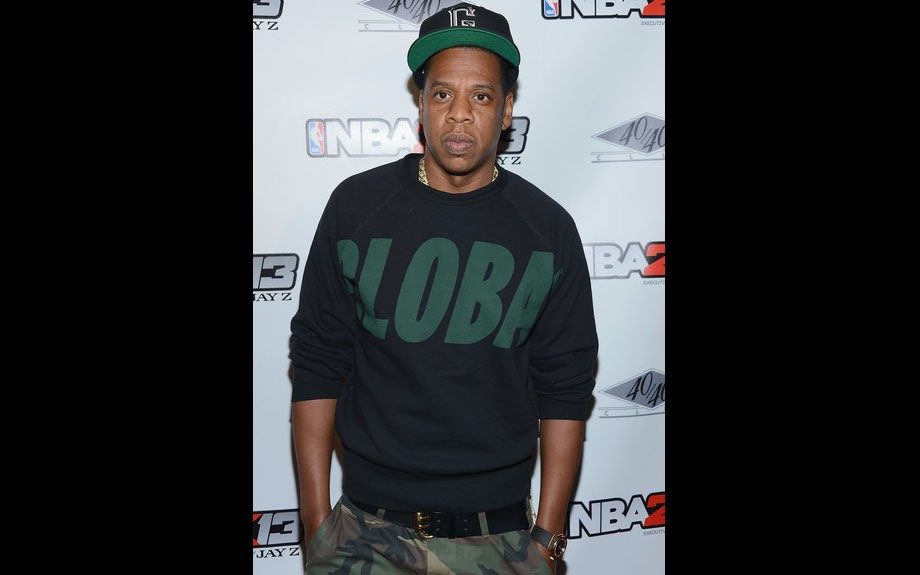 Jay-Z attended NBA 2K13 Live event in a Global sweatshirt, camouflage pants, and a fitted cap.