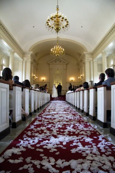 Stunning photo of the aisle lined with ivory rose petals