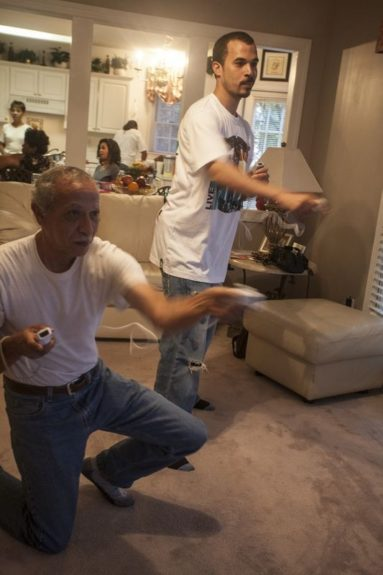 """Howard and his dad on Wii. Amal loves spending time down South with grandparents. Amal recounts, """"When we go to my dad's parents in the summer, we have fun. We eat soul food. And to me, it seems most African-Americans are more knowledgable of that side of our culture."""""""