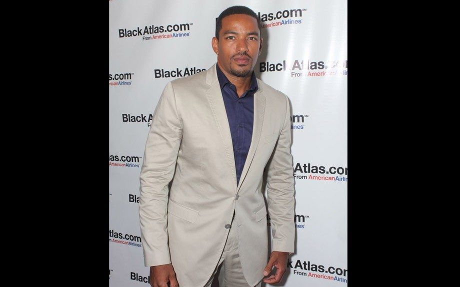 Crème suit with indigo colored shirt at Black Atlas/American Airlines event