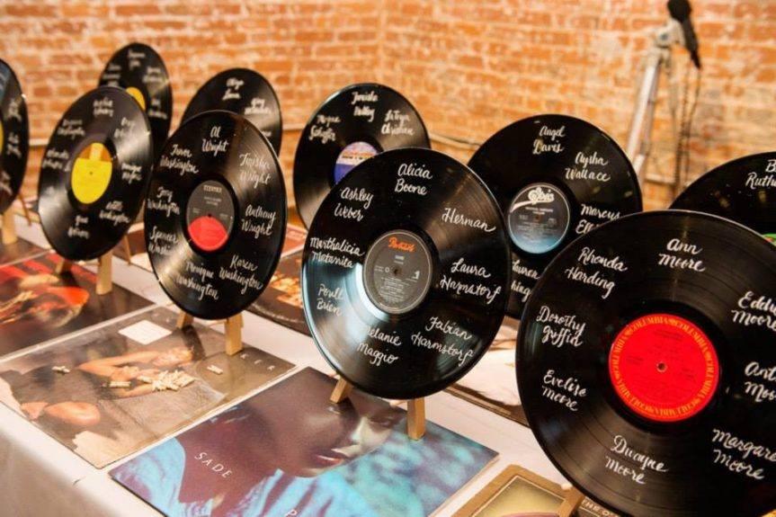 The couplenoted the guests table seating chart with retro vinyl records.
