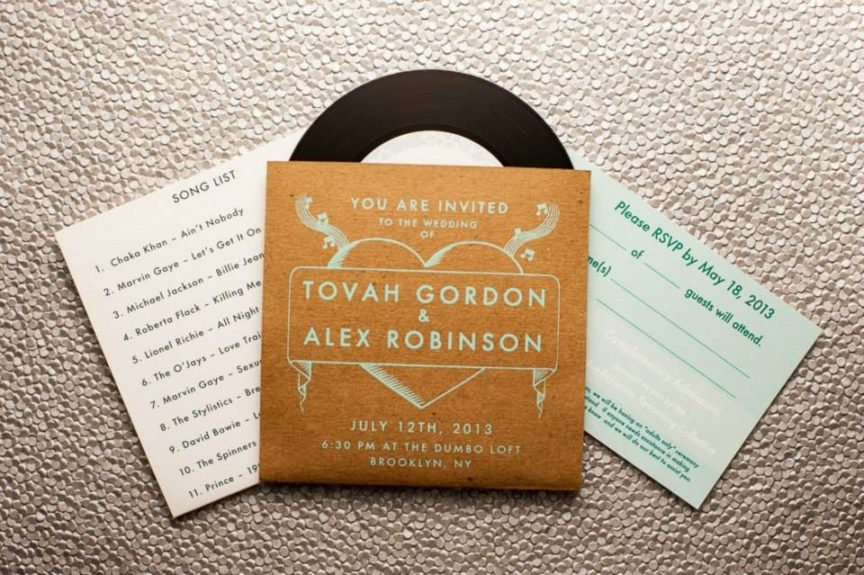 Album cover invitations with an old school song list was the perfect retro welcome to their celebration.