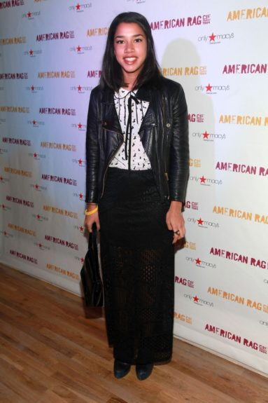 Hannah Bronfman channels rocker girl chic in a fitted leather moto jacket and sheer long skirt at an American Rag event in New York
