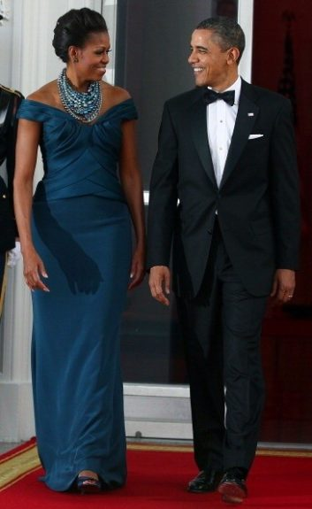 First Lady Michelle Obama looks stunning in this navy Marchesa gown, and Tom Binns necklace. The first couple hosted the State Dinner at the White House on Thursday, March 15