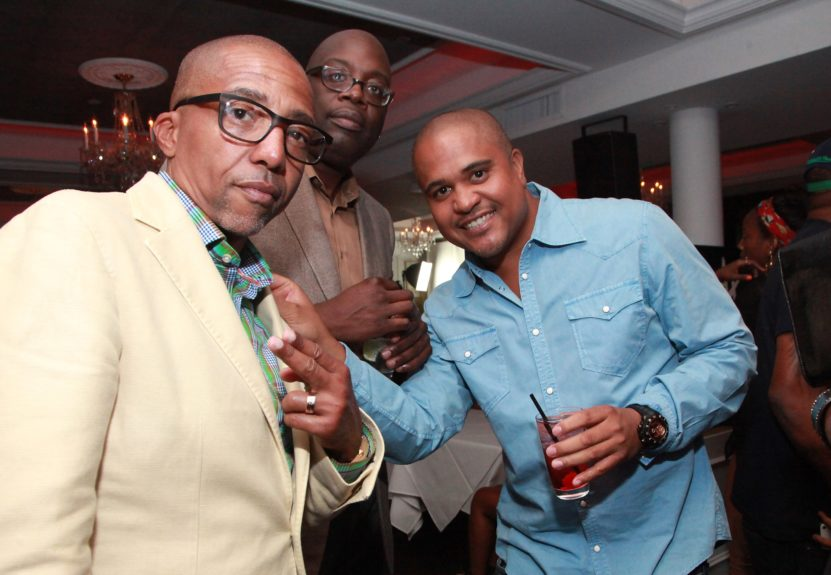 Kevin Liles and Irv Gotti poses with friend