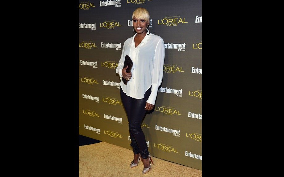 Nene Leaks attended the Entertainment Weekly Pre-Emmy Party in West Hollywood, in a sheer white button-front blouse, skinny pants, and Louboutin pumps.